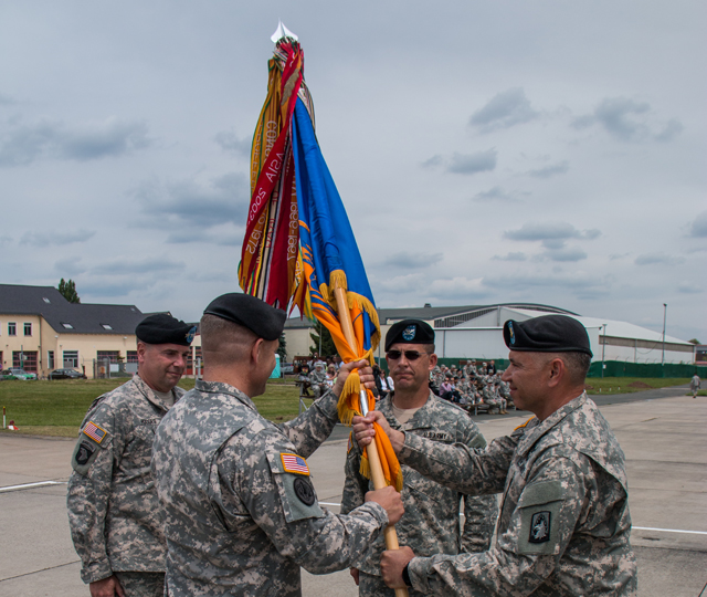 ANSBACH, Germany (June 26, 2015) -- Lt. Gen. Ben Hodges, commander of U.S. Army Europe, and Col. Christopher W. Waters, commander of 12th Combat Aviation Brigade, observe Col. Vincent H. Torza, the outgoing commander of 12th CAB, receive the unit colors for the last time from Command Sgt. Maj. Osvaldo Martell, the brigade command sergeant major, June 25 on Katterbach Army Airfield.