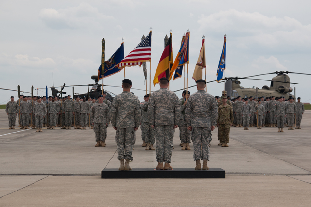 Lt. Gen. Ben Hodges, commander of U.S. Army Europe, Col. Christopher W. Waters, commander of 12th Combat Aviation Brigade, and Col. Vincent H. Torza, outgoing brigade commander, stand before the Soldiers of the 12th CAB during the brigade's change of command ceremony June 25 on Katterbach Army Airfield. (Photo by Spc. Duwayne Odom Jr., 12th CAB Public Affairs)