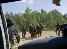 Staff Sgt. Carlos Cruz, left, crew chief of Chock 4, a UH-60M Black Hawk flown by Soldiers assigned to B Company, 43rd Assault Helicopter Battalion, 3rd Cavalry Regiment, 3rd Infantry Division, watches as a German army reconnaissance platoon evacuates a casualty during a joint training exercise at the Gen. Silvestras Zukauskas Training Area in Pabrade, Lithuania, June 14, 2015, as part of exercise Saber Strike 2015. Saber Strike is a longstanding U.S. Army Europe-led cooperative training exercise. (U.S. Army photo by Sgt. James Avery, 16th Mobile Public Affairs Detachment)