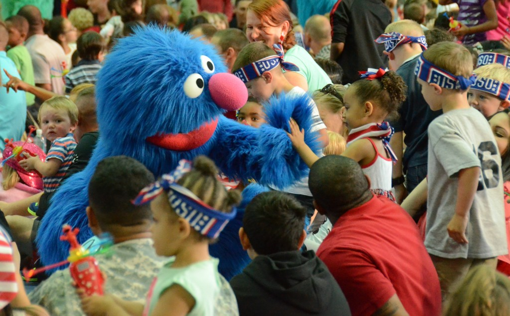 "ANSBACH, Germany (June 25, 2015) -- Grover, Muppet and resident of Sesame Street, interacts with a young fan. Families with young children gathered at the Katterbach Fitness Center June 24 to watch Sesame Street characters perform in ""Sesame Street/USO Experience for Military Families: Moving Day."" (U.S. Army photo by Bryan Gatchell, USAG Ansbach Public Affairs)"