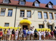 ANSBACH, Germany (July 24, 2015) -- Members of the USAG Ansbach ACS staff stand together in front of the Katterbach Kaserne ACS building. The staff of U.S. Army Garrison Ansbach's Army Community Service put together a birthday barbecue today at their location at Katterbach Kaserne to celebrate the 50th anniversary of the establishment of the Army Community Service in the Army. (U.S. Army photo by Bryan Gatchell, USAG Ansbach Public Affairs)