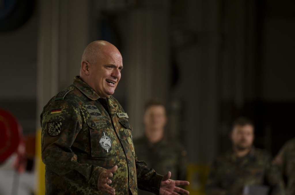 Sgt. Maj. Klaus Meyer from the Bundeswehr-Reservisten (German Armed Forces) addresses the formation of US Soldiers at Shipton Kaserne, Ansbach, Germany, July 13, 2015, as part of the German Armed Forces proficiency badge award ceremony given to Soldiers from the 412th ASB, 12th Combat Aviation Brigade. (U.S. Army photo by Sgt. Thomas Mort, 12th Combat Aviation Brigade Public Affairs)