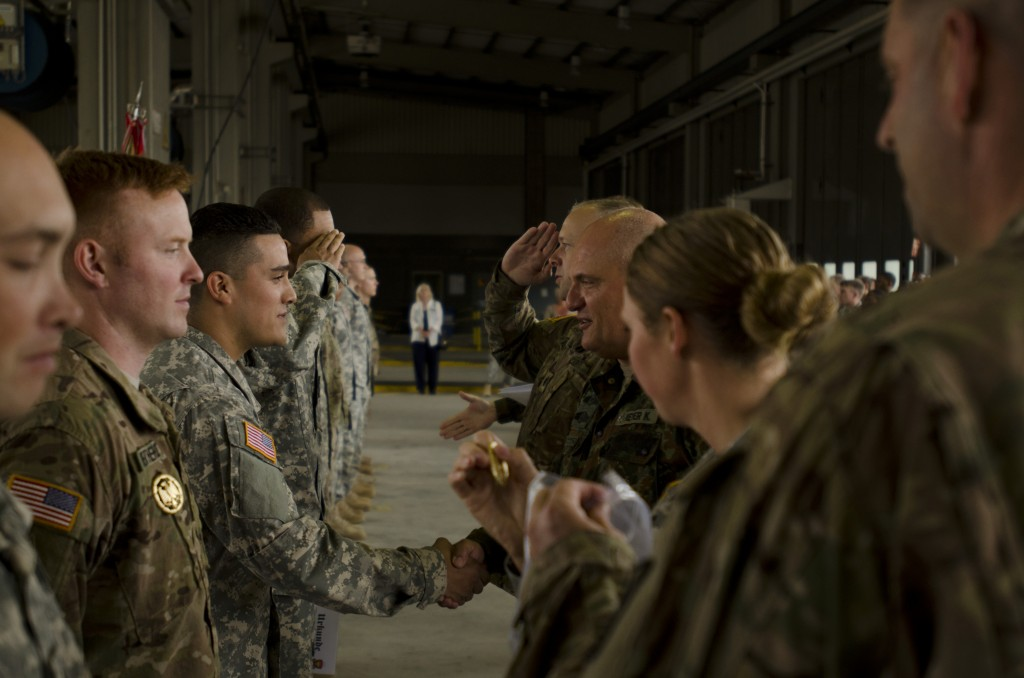 Soldiers from the 412th Aviation Support Battaion are awarded the German Armed Forces proficiency badge at Shipton Kaserne, Ansbach, Germany, July 13, 2015,. The German Armed Forces proficiency badge award is given to U.S. Soldiers who complete a series of events that test the durability and endurance of the individual. (U.S. Army photo by Sgt. Thomas Mort, 12th Combat Aviation Brigade Public Affairs)