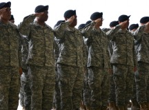 Soldiers from 5th Detachment, 603rd ASB, 12th Combat Aviation Brigade salute as the national anthem plays during their activation ceremony in Ansbach, Germany on Katterbach Army Airfield, July 20, 2015, the 5th detachment will provide major maintenance and subcomponent level repair for the AH-64D (Apache), maintain air combat power and will save the 12th CAB in repair costs.  (U.S. Army photo by Spc. Nicholas Redding, 12th CAB)