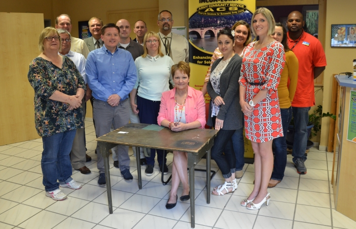 """ANSBACH, Germany (July 23, 2015) -- The staff of the U.S. Army Garrison Ansbach Army Community Service pose for a photo. ACS at USAG Ansbach is set to celebrate ACS's 50 years of service with a """"birthday party"""" Friday, July 24 from 11:30 a.m. to 3 p.m. at the garrison's ACS headquarter building lawn at Katterbach Kaserne. (U.S. Army photo by Bryan Gatchell, USAG Ansbach Public Affairs)"""