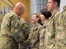 U.S. Army Gen. Ray T. Odierno, Army chief of staff (left), presents coins to soldiers assigned the 4th Infantry Division's (4th Inf. Div.) at  the 7th Army Joint Multinational Training Command's Grafenwoehr Training Area, Germany, July 9, 2015. Fourth Inf. Div. out of Fort Carson, Colo., is the U.S. Army's division regionally aligned with U.S. Army Europe and is validating the Army's concept for regionally aligned forces. (U.S. Army photo by Visual Information Specialist Gertrud Zach/released)