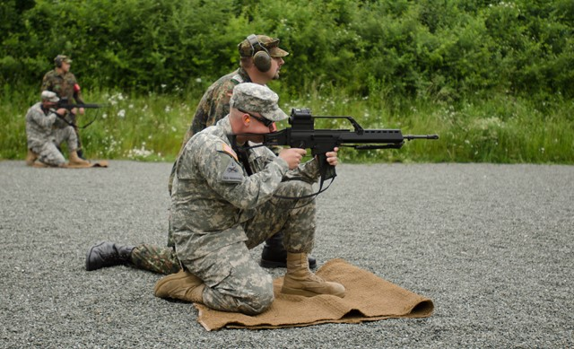 Two Soldiers from the 3rd Assault Helicopter Battalion, 158th Aviation Regiment, 12th Combat Aviation Brigade, take aim while qualifying with the Bundewher's Heckler & Koch G36 Assault Rifle, June 10, 2015, at the Roth, Germany shooting range as part of the German and U.S. armies' marksmanship assessment. (U.S. Army photo by Sgt. Thomas Mort, 12th Combat Aviation Brigade Public Affairs)