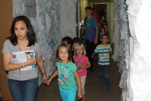 """Crew leaders assist 104 registered children through the """"ice cave"""" to one of six stations throughout each day. (Courtesy photo)"""