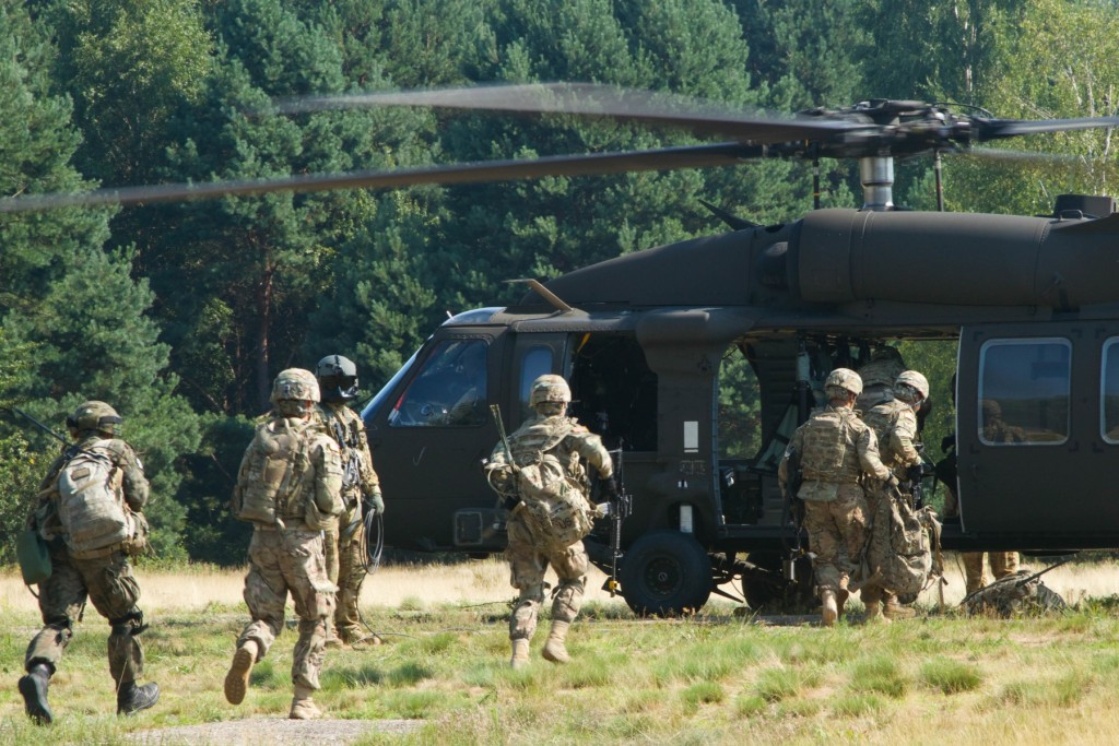 Soldiers with P Troop, 4th Squadron, 2nd Cavalry Regiment, conduct an air assault training exercise, Aug. 7, 2015, at the Nowa Deba Training Area in Poland. The Soldiers used a UH-60L Black Hawk helicopter from the 4th Battalion, 3rd Aviation Regiment (Assault Helicopter Battalion), Task Force Brawler. The training is part of Operation Atlantic Resolve, an ongoing multinational partnership focused on combined training and security cooperation between NATO allies. Led by the mission command element of the 4th Infantry Division and in conjunction with European partner nations, Atlantic Resolve is intended to improve combined operational capability in a range of missions and ensure the continued peace and stability of Europe. (U.S. Army photo by Spc. Marcus Floyd, Army News Service)