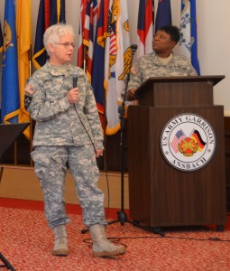 ANSBACH, Germany (Aug. 31, 2015) -- Col. Rebecca R. Tomsyck, left, officer in charge of behavioral health at Katterbach Army Health Clinic, speaks about women's suffrage and other subjects after being introduced by Staff Sgt. Eran Foye, the master of ceremonies. In celebration of 95 years of women's suffrage in the United States, U.S. Army Garrison Ansbach and the 12th Combat Aviation Brigade held a Women's Equality Day observation at the Von Steuben Community Center Wednesday, Aug. 26. (U.S. Army photo by Andy Gracklauer, Franconian News)