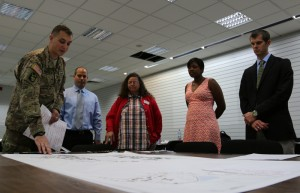 ANSBACH, Germany (Sept. 22, 2015) -- Capt. Robert Kelly, left, a liaison for 12th Combat Aviation Brigade, discusses future plans over a map of Katterbach District. Over the course of a few days recently, stakeholders of the USAG Ansbach community convened with a master planning team to survey and plan for the future of Katterbach Kaserne, Bismarck Kaserne and Shipton Kaserne -- three sites collectively known as the Katterbach District. (U.S. Army photo by Bryan Gatchell, USAG Ansbach Public Affairs)