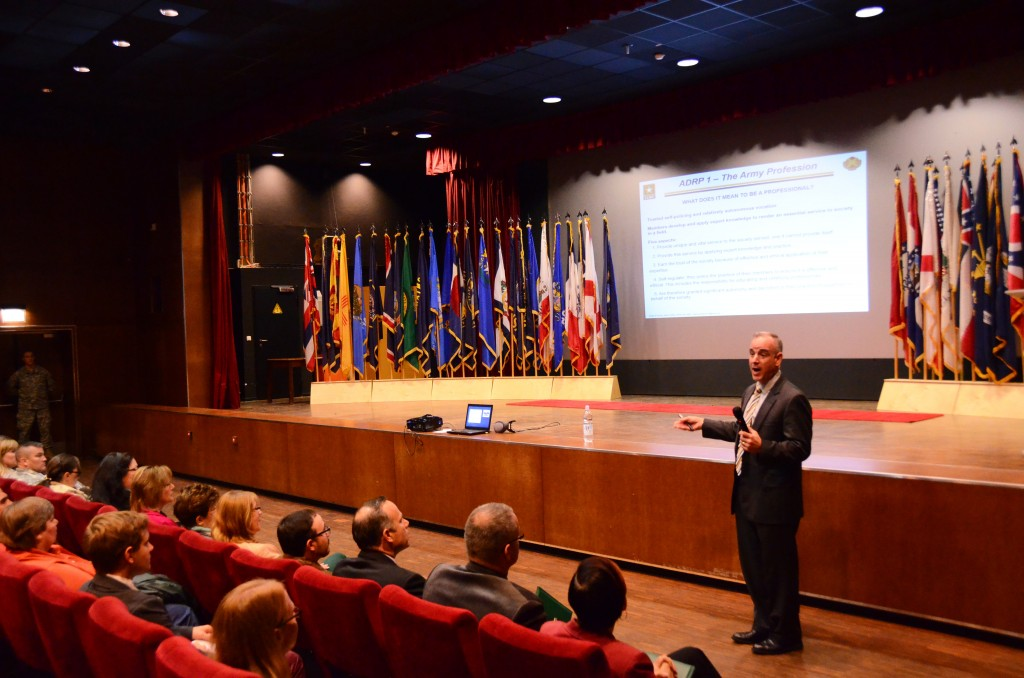 ANSBACH, Germany (Sept. 10, 2015) -- Installation Management Command Europe Region Director Michael D. Formica speaks to employees of U.S. Army Garrison Ansbach about what it means to be an Army professional, during a Sept. 9 workforce town hall at the garrison's Bismarck Theater. (U.S. Army photo by Stephen Baack, USAG Ansbach Public Affairs)