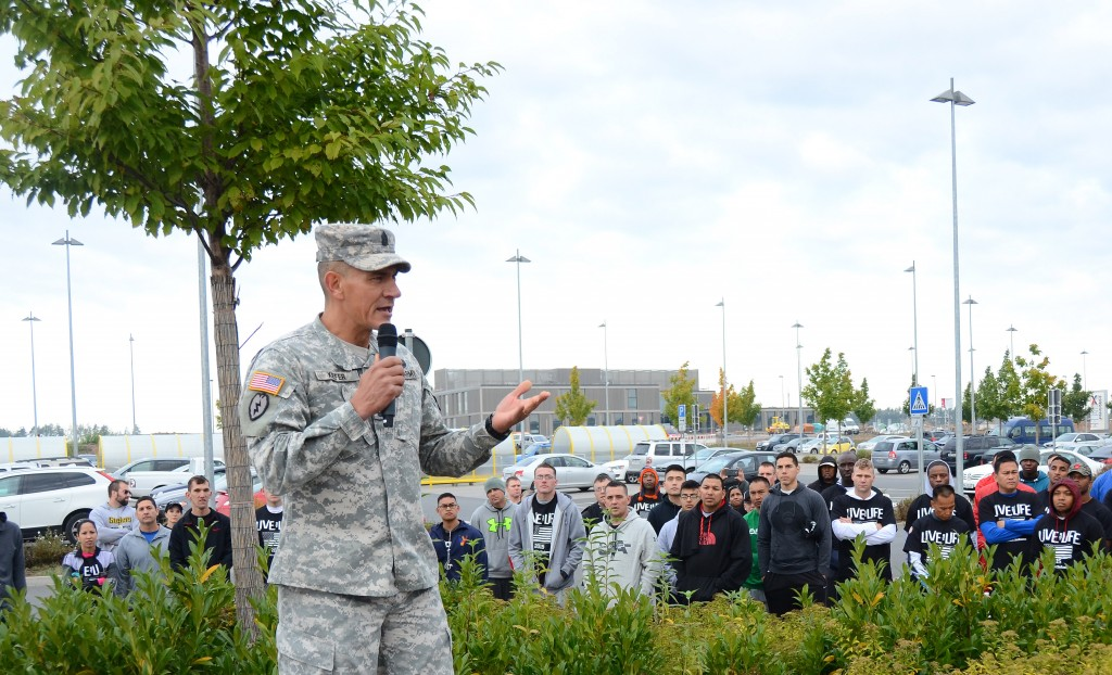 U.S. Army Garrison Ansbach Command Sgt. Maj. Mark A. Kiefer speaks to the crowd gathered Sept. 25 in front of the Commissary at Urlas before USAG Ansbach's 2015 Suicide Prevention Month 3K Walk/Run. (U.S. Army photo by Stephen Baack, USAG Ansbach Public Affairs)