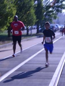 Participants run along the boardwalk at Katterbach Kaserne during the Back-to-School fun run.