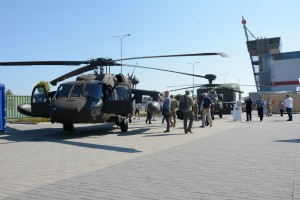 Polish citizens get a first-hand look at a UH-60 Black Hawk from 4-3 CAB and at an AH-64 Apache from 12th CAB during the Polish Armed Forces' Exhibition of Equipment and Armaments at the Targi Kielce Exabition and Congress Center, Sept. 2, 2015. (U.S. Army photo by Capt. Jaymon Bell /released)