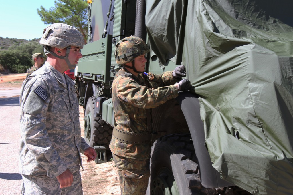 """CHANIA, Greece (Sept. 28, 2015) -- Spc. Josh Wagner, a Soldier with the 5th Battalion, 52nd Air Defense Artillery Regiment, and Sgt. 1st Class Philipp Wagenknecht, a German soldier with SAM Wing 1, prepare German Patriot systems for movement during a training exercise Sept. 28 as part of """"Rapid Arrow,"""" a bi-national live-fire exercise at the NATO Missile Firing Installation here. (U.S. Army photo by Sgt. 1st Class Randall Jackson)"""
