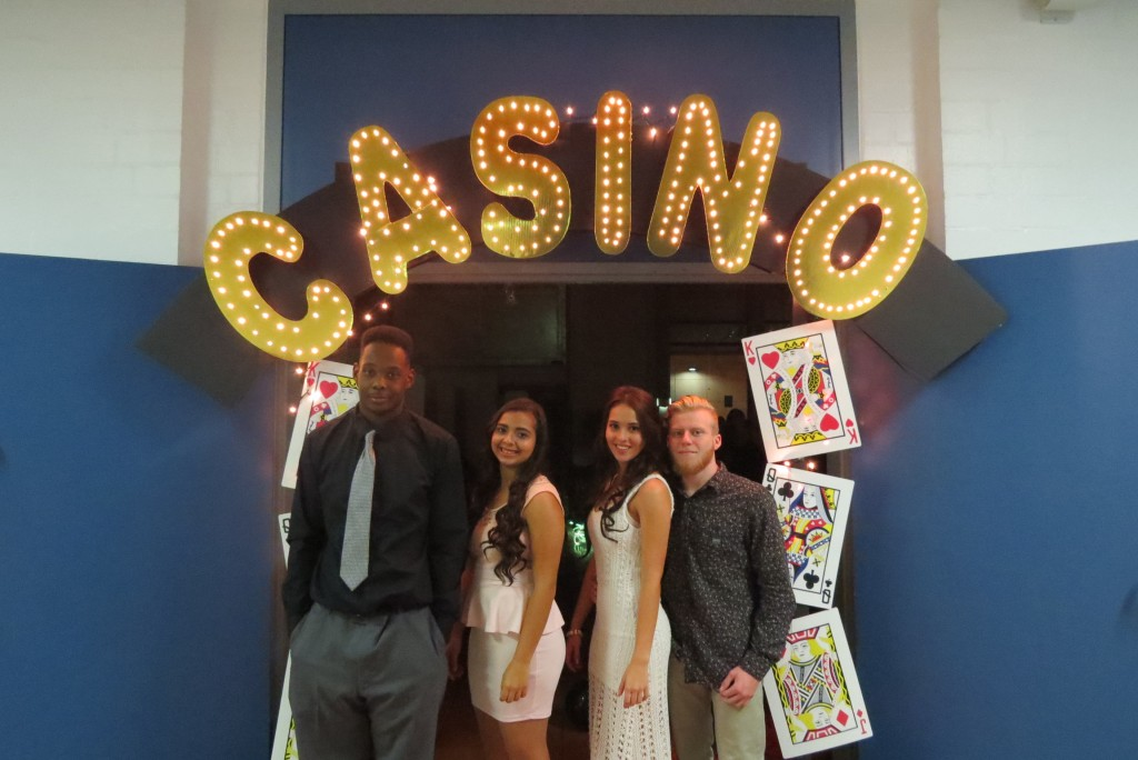 Students prepare to enter the casino-themed homecoming dance. (Photo by Christian Pascual, Ansbach High School yearbook staff.)