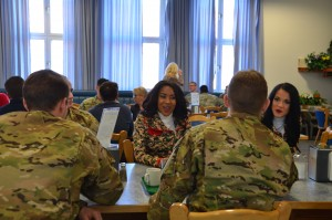 Cheerleaders with the Kansas City Chiefs eat and visit with Soldiers at the Wings of Victory Dining Facility.