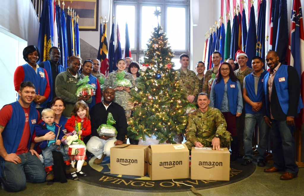 Volunteers with the U.S. Army Garrison Ansbach American Red Cross join Soldiers at the 12th Combat Aviation Brigade operations center Dec. 25 shortly after the volunteers delivered gift boxes courtesy of Amazon. (Photo by Cassandra Wyatt, USAG Ansbach Red Cross Station Manager.)