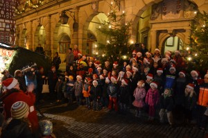 Students of Ansbach Elementary School conclude a performance of Christmas songs at the Rothenburg ob der Tauber Rathaus, or town hall, Dec. 8.