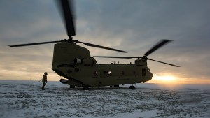 Spc. Raymond Rader, a CH-47 Helicopter repair technician, returns to his CH-47 Chinook after rigging and inspecting a payload prior to the sling load training at Katterbach Army Airfield, Jan. 20.