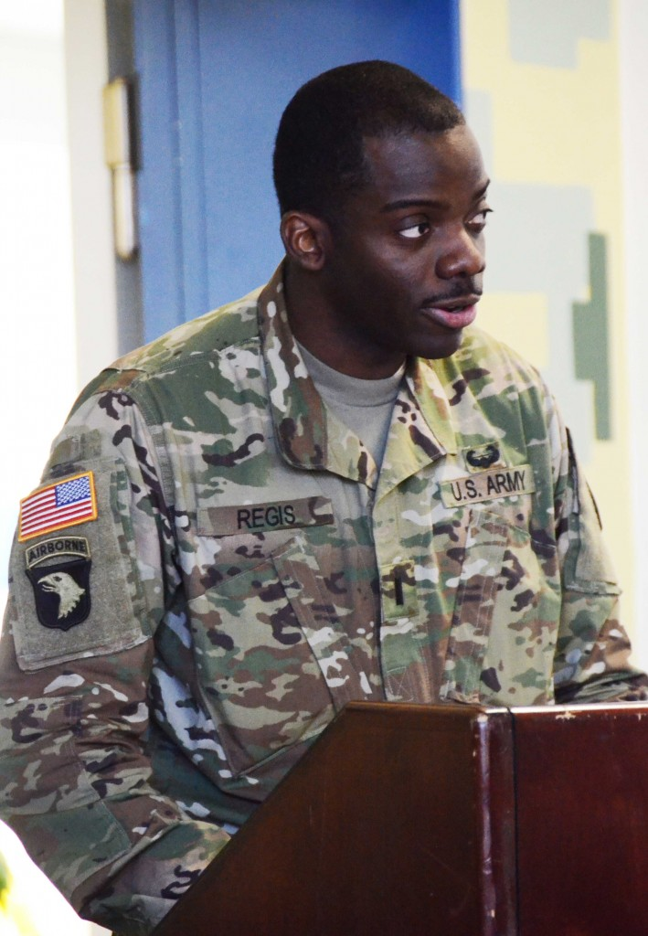 First Lt. Elie Regis Jr., 12th Combat Aviation Brigade executive officer, provides opening remarks at the U.S. Army Garrison Ansbach and 12th CAB Martin Luther King Jr. Day observance Jan. 29 at Katterbach's Wings of Victory Dining Facility.