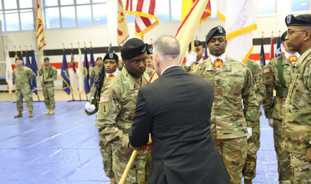 Michael Formica, director of IMCOM Europe, presents the organization's guidon to Command Sgt. Maj. Gene Canada during the region's change of responsibility ceremony Jan. 12, 2016. (U.S. Army photo by Harald Risch)