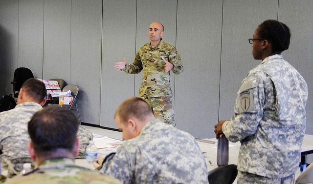 Staff Sgt. Eric Jimenez, assigned to the Army Public Health Center, educates leaders on the Army Performance Triad, October 20, 2015, at Fort Benning, Georgia. The Army Performance Triad is a comprehensive plan to improve readiness and resilience through public health initiatives and leadership engagement. (U.S. Army photo by Master Sgt. Brad Burgess.)