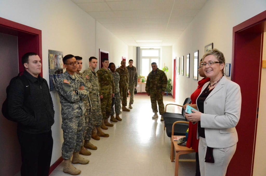 Irina McNemee, right, education services officer at the Ansbach Education Center, welcomes visitors to Student Appreciation Day at the facility Feb. 10, 2016. (Photo by Stephen Baack, USAG Ansbach Public Affairs)