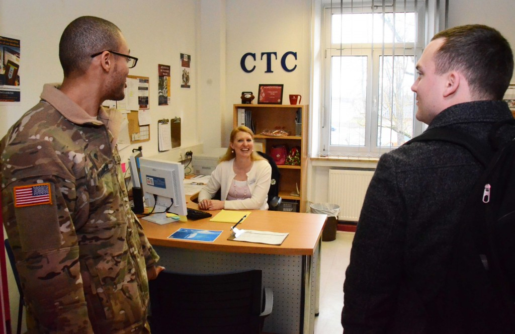 Lindsay Hamilton, site coordinator for Central Texas College, talks to two visitors during Student Appreciation Day at the Ansbach Education Center Feb. 10, 2016: Spc. Antonio Plummer, left, assigned to 1st Battalion, 3rd Aviation Regiment, 12th Combat Aviation Brigade; and Spc. Jeremy McCabe, assigned to Headquarters and Headquarters Detachment, U.S. Army Garrison Ansbach. (Photo by Stephen Baack, USAG Ansbach Public Affairs)