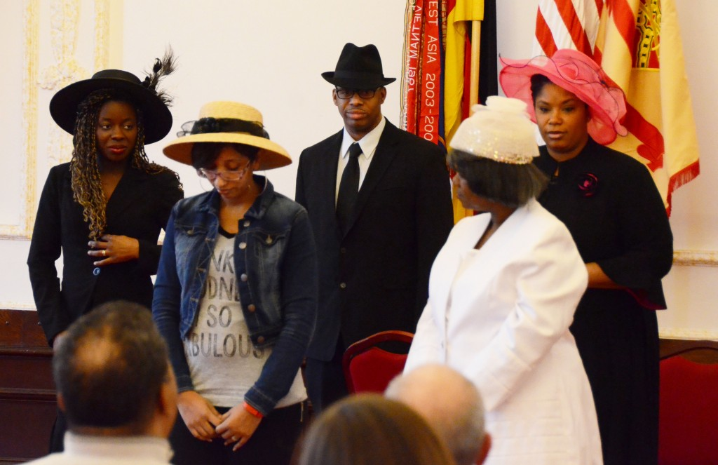 """Five performers who are preparing for U.S. Army Garrison Ansbach Family and Morale, Welfare and Recreation's production of """"Crowns"""" act out a 10-minute excerpt of the play Feb. 23, 2016, during the garrison's observance of Black History Month observance."""