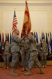 Cuvellier, left, receives the U.S. Army Garrison Ansbach colors from Col. Christopher M. Benson, USAG Ansbach commander, signifying Cuvellier's assumption of responsibility as command sergeant major.