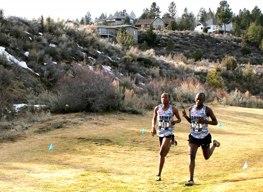 Spc. Hillary Bor (left, bib No. 180) and his brother, Spc. Emmanuel Bor (right, No. 179), lead All-Army runners at the 2016 Armed Forces Cross Country Championships, run Feb. 6 in conjunction with the USA Track and Field Winter National Cross Country Championships in Bend, Oregon. Hillary won the 10-kilometer race in 32 minutes, 37 seconds, and Emmanuel was second in 32:39, to help All-Army win the team crown for the third consecutive year. (U.S. Army photo by Thomas Higgins, All Army Sports)