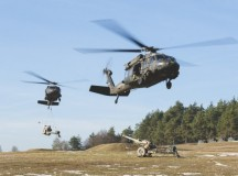 Blackhawk helicopters from 3rd Battalion, 227th Aviation Regiment, 1st Air Cavalry Brigade, 12th Combat Aviation Brigade, conduct M119A3 Howitzer Sling Load Operations, alongside 4th Battalion 319th Airborne Field Artillery Regiment, 173rd Airborne Brigade, during exercise Allied Spirit IV at the U.S. Army's Joint Multinational Readiness Center in Hohenfels Training Area, Germany, Jan. 26. (U.S. Army photo by Spc. Antonio Ramirez, 12th CAB)