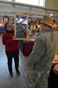 Chaplain (Lt. Col.) Jerzy Rzasowski checks out how he looks in hat while visiting the bazaar.