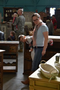 Christina Bayse carries son John Jr. through the bazaar.