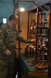 Col. Christopher M. Benson, U.S. Army Garrison Ansbach commander, checks out hourglasses at the bazaar.