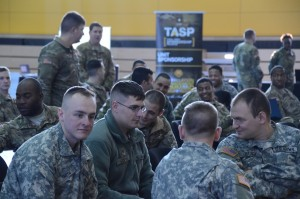Soldiers gather and take seats before the event.