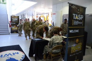 Soldiers sign up as they arrive to the rodeo.