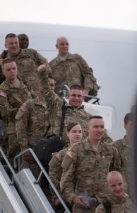 "Soldiers of the 1st Armored Division Combat Aviation Brigade, ""Iron Eagles"", from Fort Bliss, Texas, arrived at Albrecht Dürer Airport, Nuernburg, Germany. (U.S. Army photo by Spc. Antonio Ramirez, 12th CAB)"