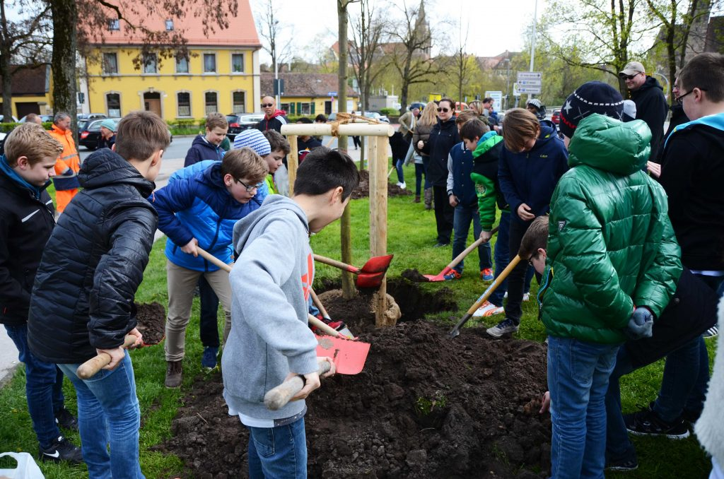 U.S. and German children and community members gather to plant three new saplings in downtown Ansbach as part of a joint German-American Arbor Day celebration April 25, 2016. (U.S. Army photo by Stephen Baack, USAG Ansbach Public Affairs)