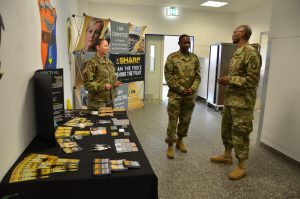 From left, Chief Warrant Officer 3 Eve Seyfried, sexual assault response coordinator for the rotational unit, and Sgt. 1st Class Dwayne Suber, SARC for 12th Combat Aviation Brigade, talk to 1st Sgt. Antonio Cowan, 12th CAB.