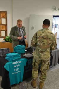 Vernon Chandler, victim advocate for U.S. Army Garrison Ansbach, hands out free commemorative T-shirts.