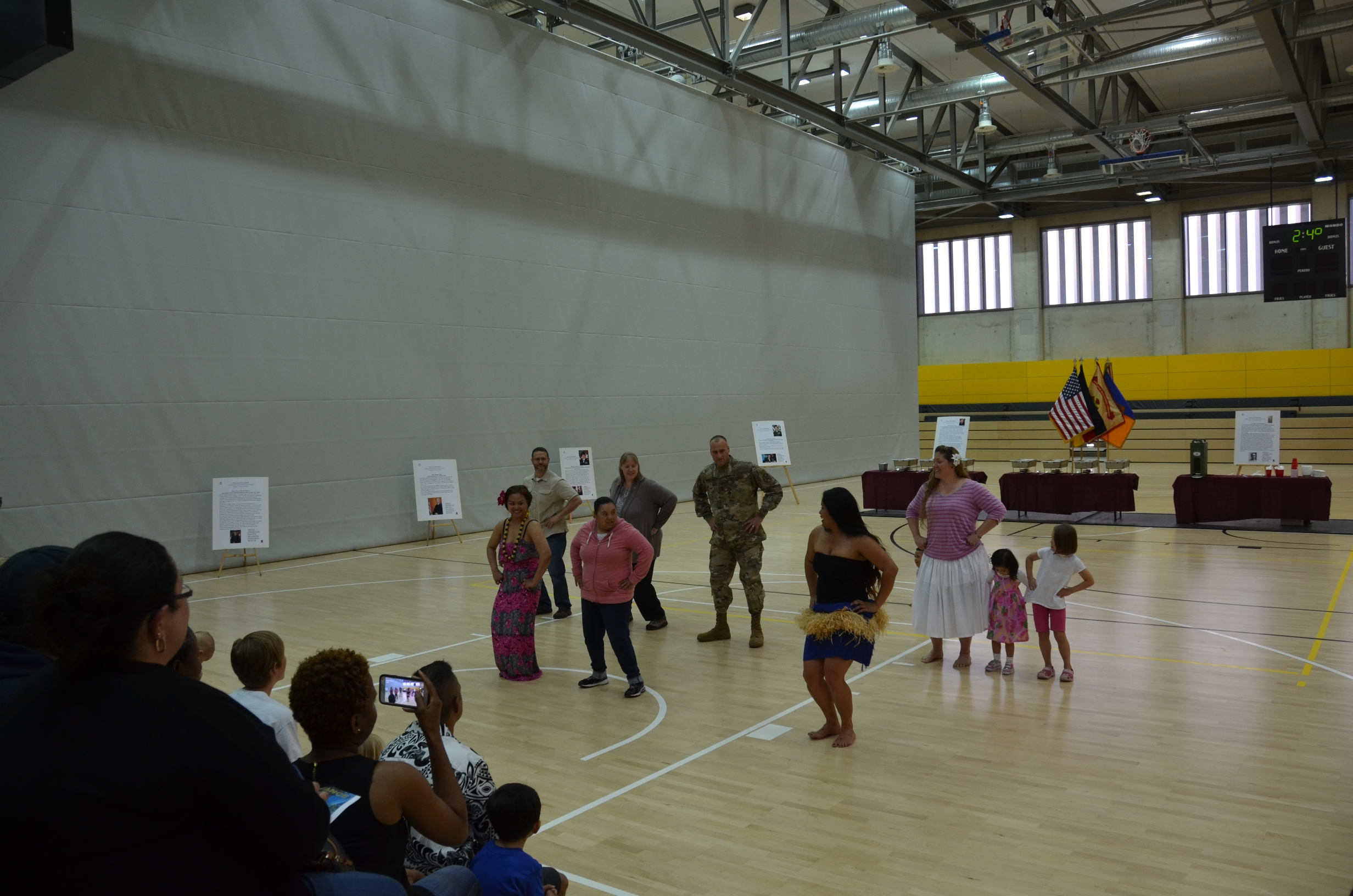 "Several community members learn a ""fruit salad"" dance during the Asian-American Pacific Islander Heritage Month event at Katterbach Fitness Center."