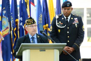 American Legion Post 1982 Commander Ken Aungst, left, speaks during the Memorial Day ceremony May 26, 2016, at Storck Barracks' Memorial Park. (U.S. Army photo by Stephen Baack, USAG Ansbach Public Affairs)
