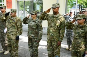 Soldiers render salutes during the Memorial Day ceremony May 26, 2016, at Storck Barracks' Memorial Park. (U.S. Army photo by Stephen Baack, USAG Ansbach Public Affairs)