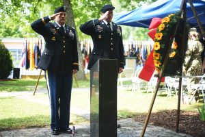 Col. Christopher M. Benson, left, U.S. Army Garrison Ansbach commander, joins Command Sgt. Maj. Derek R. Cuvellier, USAG Ansbach command sergeant major, render salutes to a ceremonial wreath during the Memorial Day ceremony May 26, 2016, at Storck Barracks' Memorial Park. (U.S. Army photo by Stephen Baack, USAG Ansbach Public Affairs)