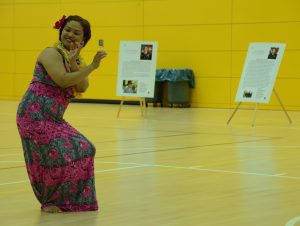 Karen Salvador, a volunteer from Grafenwoehr, performs a traditional Pacific Island dance.