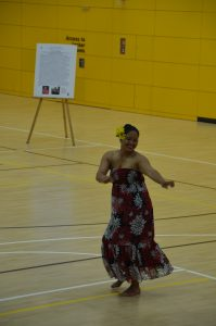Cristina Salvador, a volunteer from Hohenfels, performs a traditional Pacific Island dance. Cristina and her sister Karen have performed at other Asian-American Pacific Island Hertiage Month observances at USAG Ansbach and other garrisons.