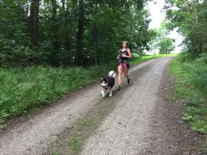Heather Luna and her pal Max run together outside Katterbach Kaserne, Germany, June 16, 2016. (U.S. Army photo by Stephen Baack, USAG Ansbach Public Affairs)